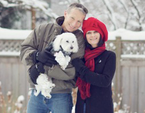 Dick Luedke, his wife and their dog