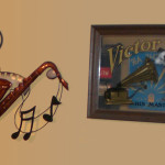 Wall sculpture of a saxophone and photo of the RCA Victor Dog